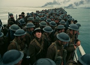 Tommy (Fionn Whitehead, foreground, looking up) is a 19-year-old English private trying to escape the German forces and make it home in Christopher Nolan's Dunkirk.