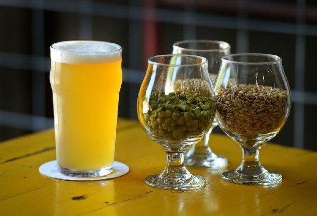 a-pint-of-a-pale-ale-brewed-from-ingredients-including-caramel-malt-white-wheat-and-citra-hop-pellets-sits-on-a-table-friday-at-ozark-beer-co-in-rogers-the-brewery-has-partnered-with-crystalbridges-museum-of-american-art-to-produce-the-beer-inspired-by-notes-found-in-a-journal-by-buckminster-fuller