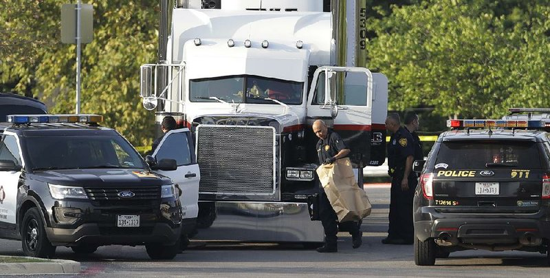 9 people found in truck parked outside Wal-Mart die