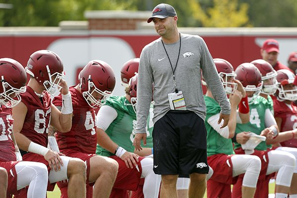 Arkansas tight ends coach Barry Lunney Jr. talks to players during warmups prior to practice Thursday, July 27, 2017, in Fayetteville.