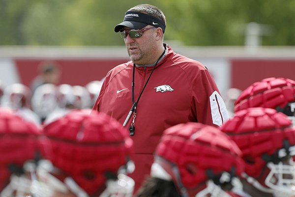Arkansas coach Bret Bielema watches warmups prior to practice Thursday, July 27, 2017, in Fayetteville.
