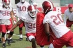 Arkansas defensive back Kevin Richardson (30) goes through tackling drills during practice Friday, July 28, 2017, in Fayetteville.
