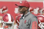 Arkansas Razorback running back coach Reggie Mitchell at the beginning of drills Friday, July 28, 2017, during practice on campus in Fayetteville.