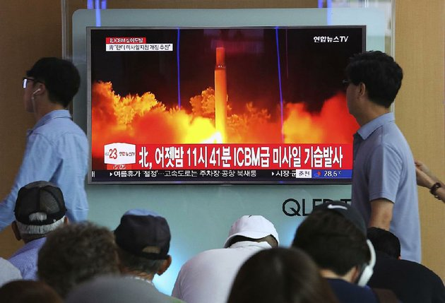 people-at-a-railway-station-in-seoul-south-korea-watch-saturday-as-a-television-news-report-shows-north-koreas-latest-test-launch-of-an-intercontinental-ballistic-missile