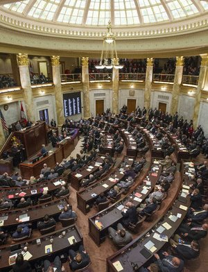Gov. Asa Hutchinson addresses a joint session of the state Legislature on Jan. 10. Hundreds of new laws passed during the 91st General Assembly take effect Tuesday.