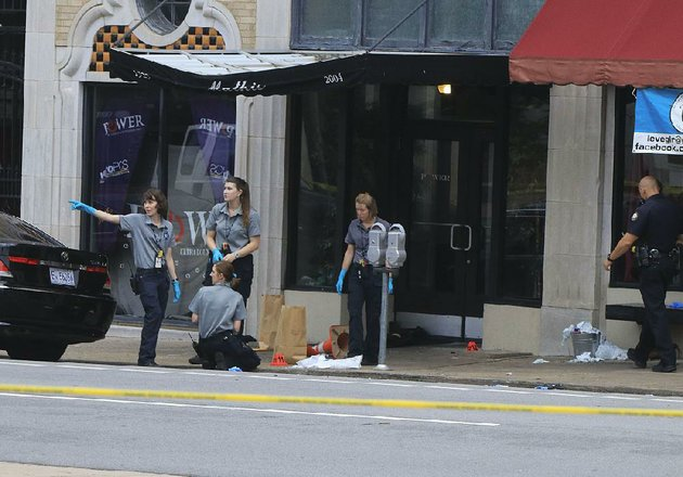 little-rock-police-department-crime-scene-personnel-collect-evidence-july-1-2017-after-a-shooting-at-the-power-ultra-lounge-at-220-w-sixth-st