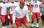 Arkansas defensive coordinator Paul Rhoads coaches players during practice Friday, July 28, 2017, in Fayetteville.