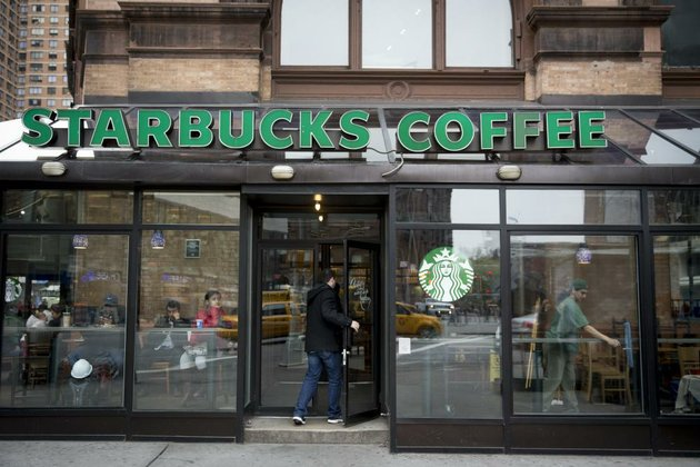 a-customer-enters-a-starbucks-corp-location-in-new-york-in-this-file-photo