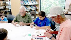 Photo Submitted. The Bella Vista Woodcarver's Club came out to the Bella Vista Public Library to teach the basics of carving…with soap!