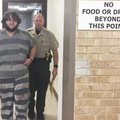 Patrick Malone, 20, of Garfield is escorted Tuesday by a Benton County Sheriff's Office deputy after...