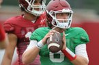 Arkansas quarterback Austin Allen prepares to pass as tight end Jeremy Patton looks on Tuesday, Aug. 1, 2017, during practice at the university's practice field in Fayetteville.