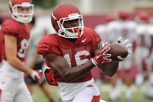 Arkansas receiver La'Michael Pettway makes a catch Tuesday, Aug. 18, 2015, during practice at the university's practice field in Fayetteville.