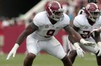 In this April 18, 2015, file photo, Alabama defensive lineman Da'Shawn Hand (9) lines up for a play during the first half of Alabama's spring NCAA college football game in Tuscaloosa, Ala. (AP Photo/Butch Dill)