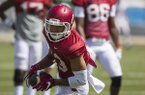 Arkansas receiver Deon Stewart runs after the catch during practice Saturday, April 15, 2017, in Fayetteville.