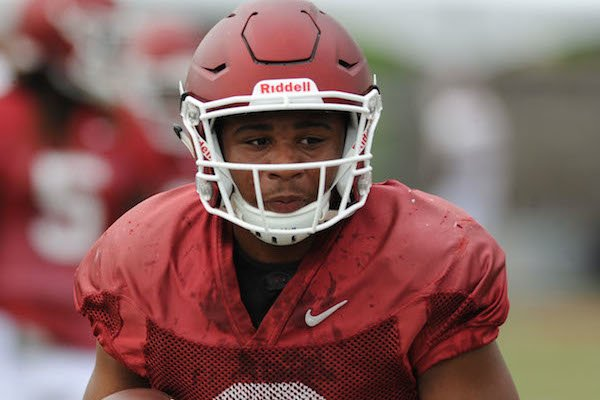 Arkansas receiver Koilan Jackson carries the ball Tuesday, Aug. 1, 2017, after making a catch during practice at the university's practice field in Fayetteville.