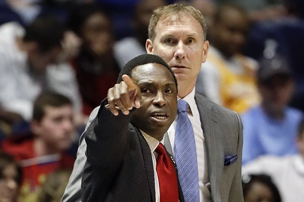 Alabama head coach Avery Johnson and associate head coach John Pelphrey, right, watch the action during the first half of an NCAA college basketball game against Mississippi State at the Southeastern Conference tournament Thursday, March 9, 2017, in Nashville, Tenn. (AP Photo/Wade Payne)