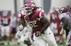Arkansas defensive end T.J. Smith (52) goes through practice April 29, 2017, in Fayetteville.