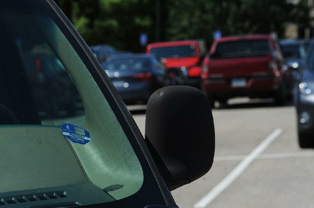 cars-sit-friday-in-lot-71-on-the-university-of-arkansas-campus-in-fayetteville-a-planned-change-to-a-new-system-of-parking-enforcement-has-been-delayed-forcing-the-university-to-continue-issuing-permit-decals-for-the-coming-academic-year