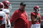 Arkansas coach Bret Bielema talks to players during practice Saturday, Aug. 5, 2017, in Fayetteville.