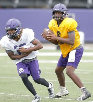 Fayetteville quarterback Darius Bowers (right) will make his first varsity start tonight as the Purple'Dogs travel to