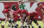Arkansas quarterback Austin Allen and the starting offensive line work during the Razorbacks first fall practice Thursday, July 27, 2017.