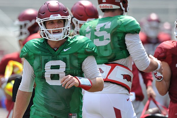 Arkansas quarterback Austin Allen returns to the sideline Saturday, Aug. 5, 2017, prior to the start of a scrimmage in Razorback Stadium in Fayetteville.