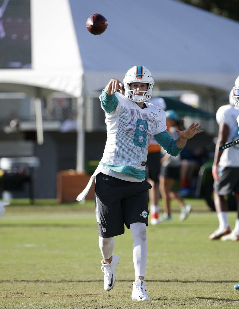 d81dcf800 Miami Dolphins quarterback Jay Cutler goes through drills with his new team  Tuesday. The Dolphins signed Cutler