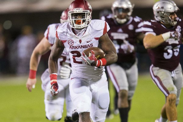 NWA Democrat-Gazette/JASON IVESTER Arkansas running back Rawleigh Williams (22) races to the end zone for a touchdown against Mississippi State on Saturday, Nov. 19, 2016, at Davis Wade Stadium in Starkville, Miss., during the second quarter.
