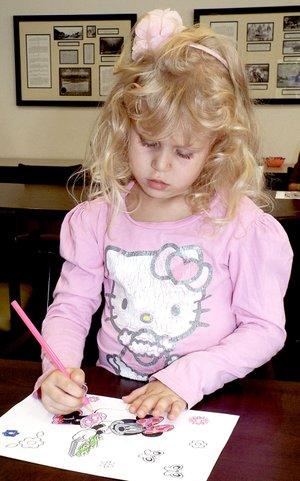 Photo by Randy Moll Abbi Felten, 5, worked on a coloring page at the Gentry Public Library August 2. She was taking part in the National Coloring Book Day observance at the library in Gentry. Gentry was one of only a few libraries in Arkansas to observe the day.
