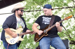 Photo by Mike Eckels Carter Beggs (left) and Cole Reeves played a guitar duet during the 64th Annual Decatur Barbecue at Veterans Park in Decatur Aug. 5. Beggs and Reeves first performed together on the same stage during the 2010 Barbecue concert as the Bobbycolecarter band.