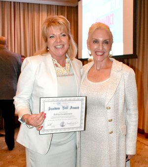 "Photo submitted State Rep. Robin Lundstrum (R-District 87) received the ""Calvin Coolidge Heroes of Freedom Award"" from Conduit for Commerce for her voting record on fiscal conservative issues in the 91st General Assembly legislative session."