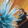 Rick Holland installs Azure Icicle Chandeleir, an artwork by Dave Chihuly in May at Crystal Bridges ...