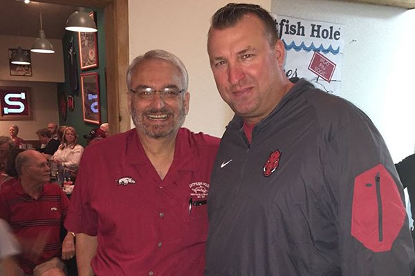 Pat Gazzola, left, was the co-owner of the Catfish Hole and a longtime supporter of the Razorbacks.