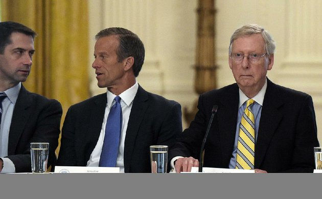 senate-majority-leader-mitch-mcconnell-of-ky-right-seated-next-to-sen-tom-cotton-r-ark-left-and-sen-john-thune-r-sd-center-waits-for-president-donald-trump-to-join-a-meeting-of-republican-senators-on-health-care-in-the-east-room-of-at-the-white-house-in-washington-tuesday-june-27-2017