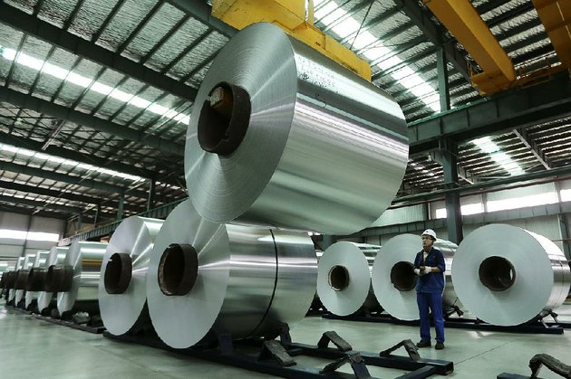 a-worker-arranges-rolls-of-aluminum-at-a-factory-in-chinas-anhui-province-the-united-states-plans-to-levy-an-import-tax-of-up-to-81-percent-on-aluminum-foil-from-china