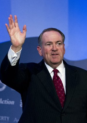 Former Arkansas Gov. Mike Huckabee waves to the crowd after speaking during the Values Voter Summit, held by the Family Research Council Action, Friday, Sept. 25, 2015, in Washington.