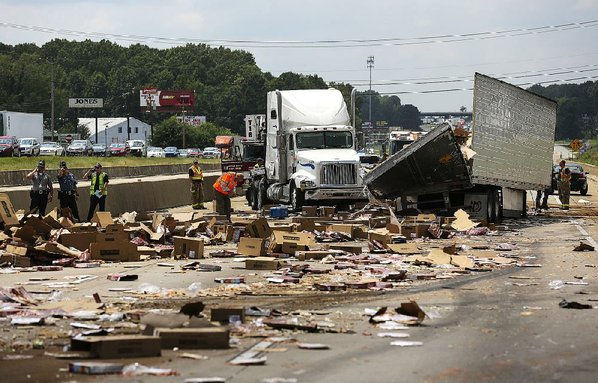 Truck crash spills frozen pizza, closing interstate