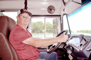 RACHEL DICKERSON/MCDONALD COUNTY PRESS McDonald County R-1 School District Transportation Director Clyde Davidson is pictured on a bus. Safety is the transportation department's highest priority, Davidson said.