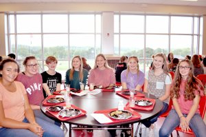 RACHEL DICKERSON/MCDONALD COUNTY PRESS Shye Hardin, left, Mollie Milleson, Jaimie Malone, Kaitlyn Cosgrove, Aubrey Forcum, Sydnie Sanny, Rylee Bradley and Azlen Smith attended Freshman Academy at McDonald County High School on Tuesday.