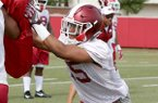 Arkansas cornerback Korey Hernandez goes through practice Thursday, July 27, 2017, in Fayetteville.