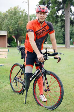 Chris Madison, a staff attorney for the city of Bryant, finished the Alaskaman Extreme Triathlon on July 15 — 10 days before the 32nd anniversary of when he lost his leg in a boating accident.