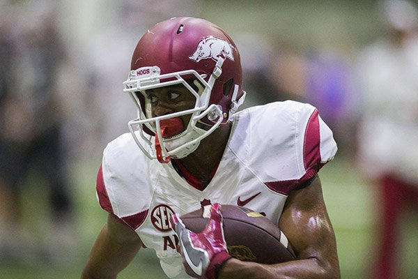 Arkansas receiver Jonathan Nance runs after the catch during a practice Saturday, April 29, 2017, in Fayetteville.