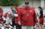 Arkansas coach Bret Bielema watches Tuesday, Aug. 1, 2017, during practice at the university's practice field in Fayetteville.