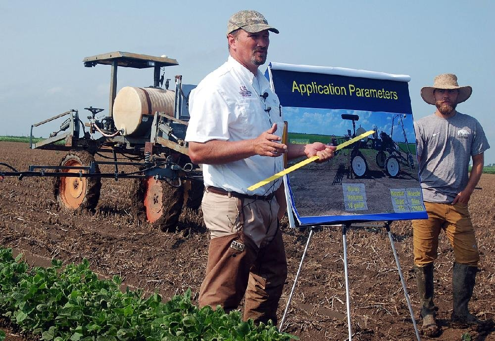 In this file photo Jason Norsworthy, a University of Arkansas professor and weed scientist, talks to field day visitors in Keiser about the tendency of the herbicide dicamba to drift from fields.