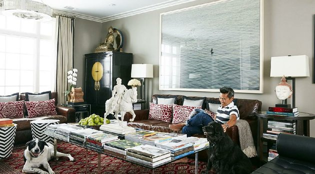 interior-designer-vern-yip-sits-on-a-couch-with-his-dogs-in-his-home-in-atlanta-with-progress-in-technology-durable-rugs-made-with-antimicrobial-stain-resistant-fibers-have-become-much-more-pleasant-to-the-touch-and-are-available-in-a-wide-range-of-styles-making-them-perfect-for-pet-owners-yip-says