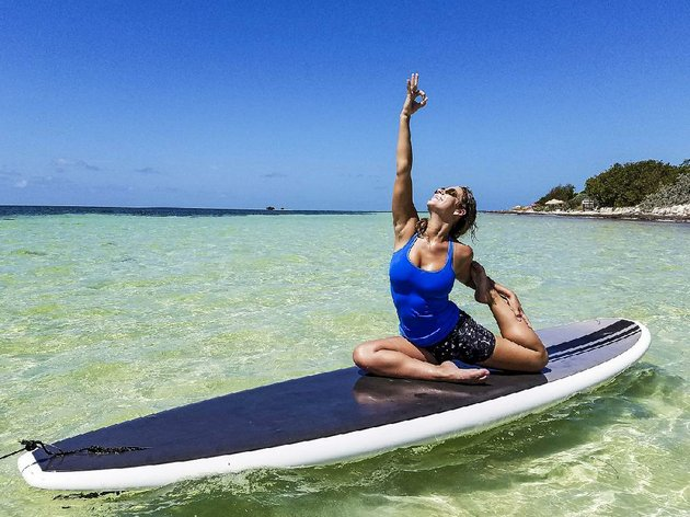 allison-wilkie-demonstrates-a-yoga-pose-on-a-stand-up-paddleboard-at-bahia-honda-state-park