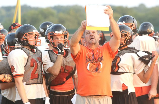 nwa-democrat-gazettedavid-gottschalk-gravette-football-coach-bill-harrelson-instructs-his-players-wednesday-during-practice-in-gravette