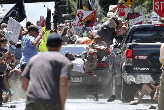 people-fly-into-the-air-as-a-vehicle-drives-into-a-group-of-protesters-demonstrating-against-a-white-nationalist-rally-in-charlottesville-va-saturday-aug-12-2017-the-nationalists-were-holding-the-rally-to-protest-plans-by-the-city-of-charlottesville-to-remove-a-statue-of-confederate-gen-robert-e-lee-there-were-several-hundred-protesters-marching-in-a-long-line-when-the-car-drove-into-a-group-of-them-ryan-m-kellythe-daily-progress-via-ap