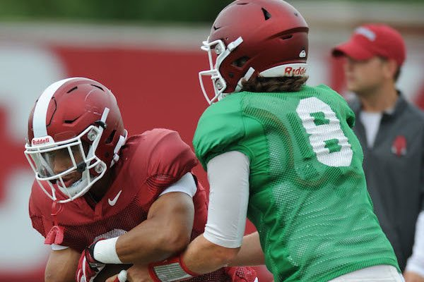 Arkansas running back Chase Hayden (left) receives the ball Tuesday, Aug. 1, 2017, from quarterback Austin Allen during practice at the university's practice field in Fayetteville.