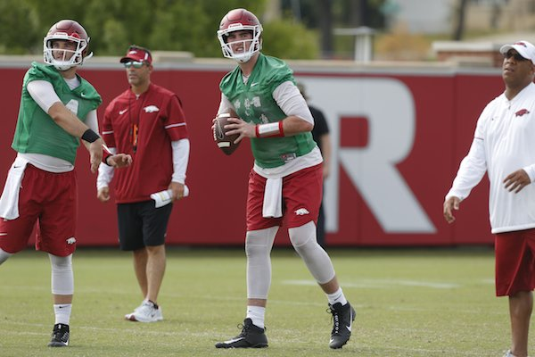 Ty Storey (left) and Cole Kelley work during Arkansas football practice Friday, July 28, 2017.